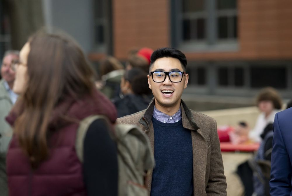 A Fox student talks with his peers outside of Alter Hall.