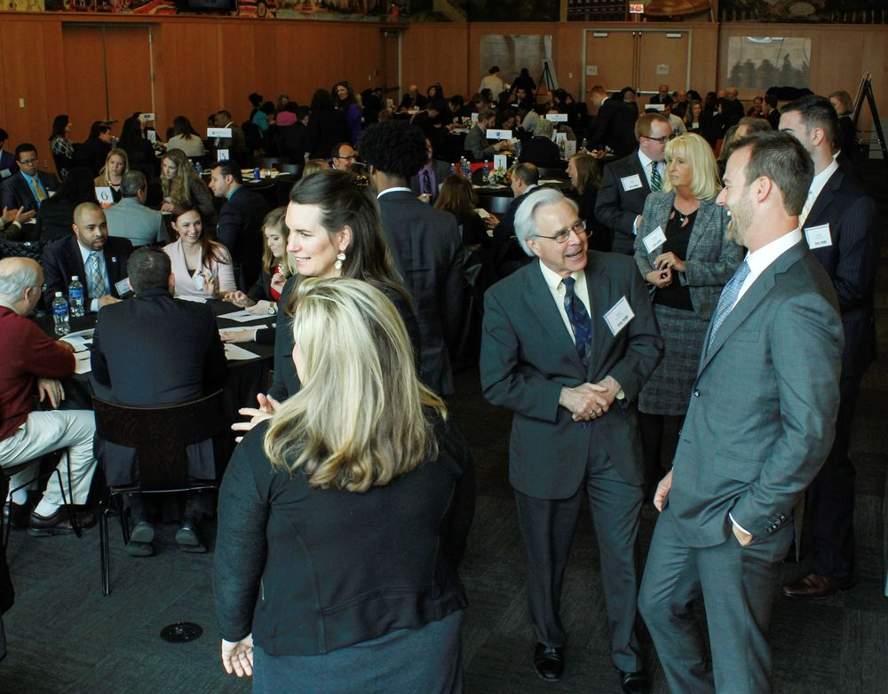 Temple Human Resource Management faculty mingle at an annual awards ceremony.
