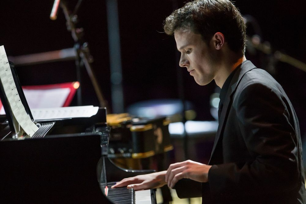 A student playing piano during a Boyer College of Music and Dance performance.