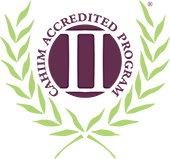 A green and purple logo for the Commission on Accreditation for Health Informatics and Information Management Education.