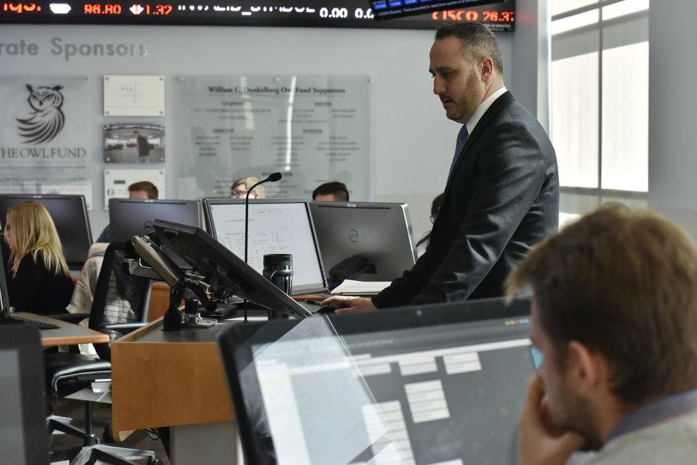 A Fox professor teaches from the Capital Markets Room.